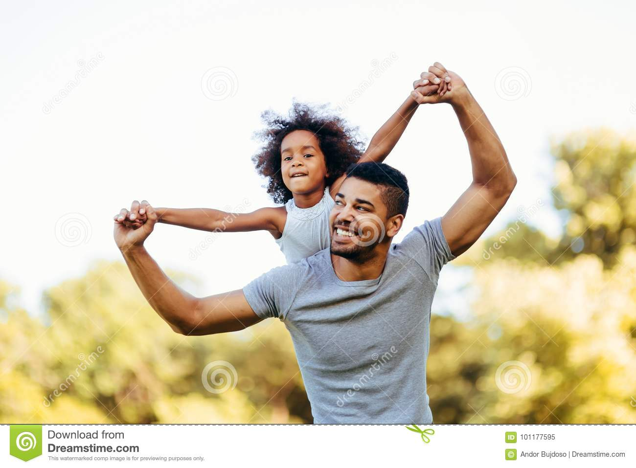 Download Portrait Of Young Father Carrying His Daughter On His Back Stock Image - Image of back, love: 101177595