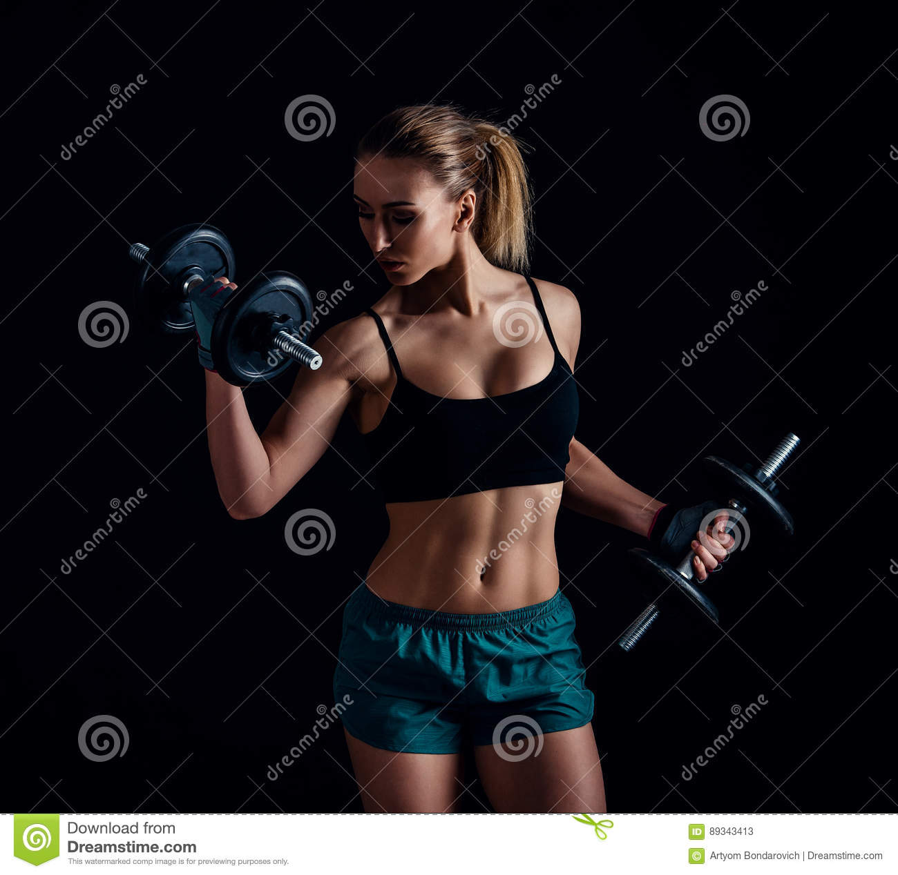 Portrait Of A Young Fitness Woman In Sportswear Doing