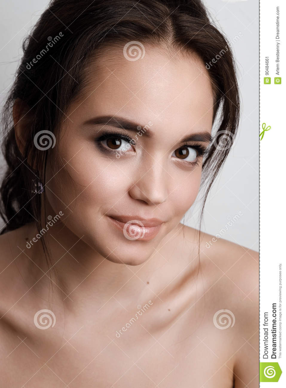 Portrait Of A Young Girl Brunette With Brown Eyes And Soft Natural