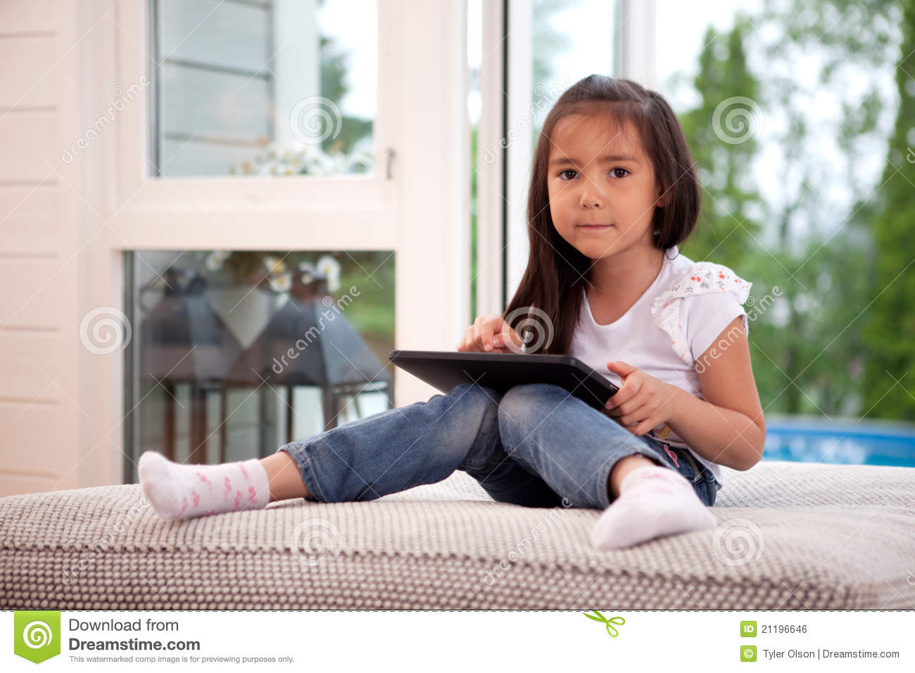 Portrait of Young Girl with Digital Tablet
