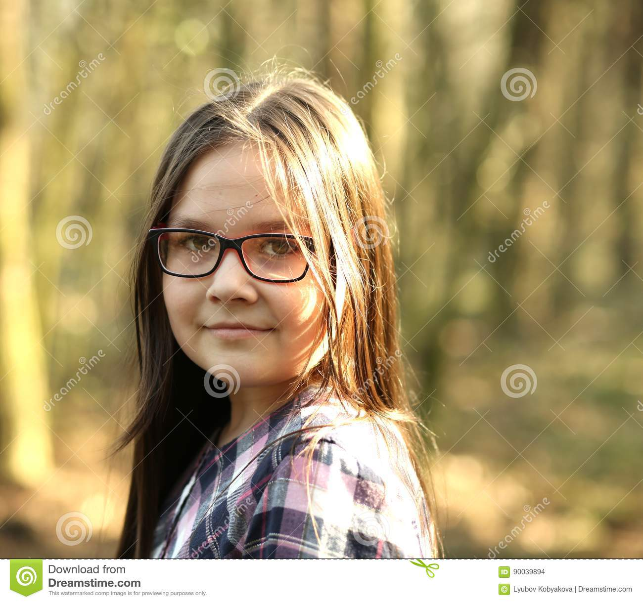 Portrait of a young girl in park