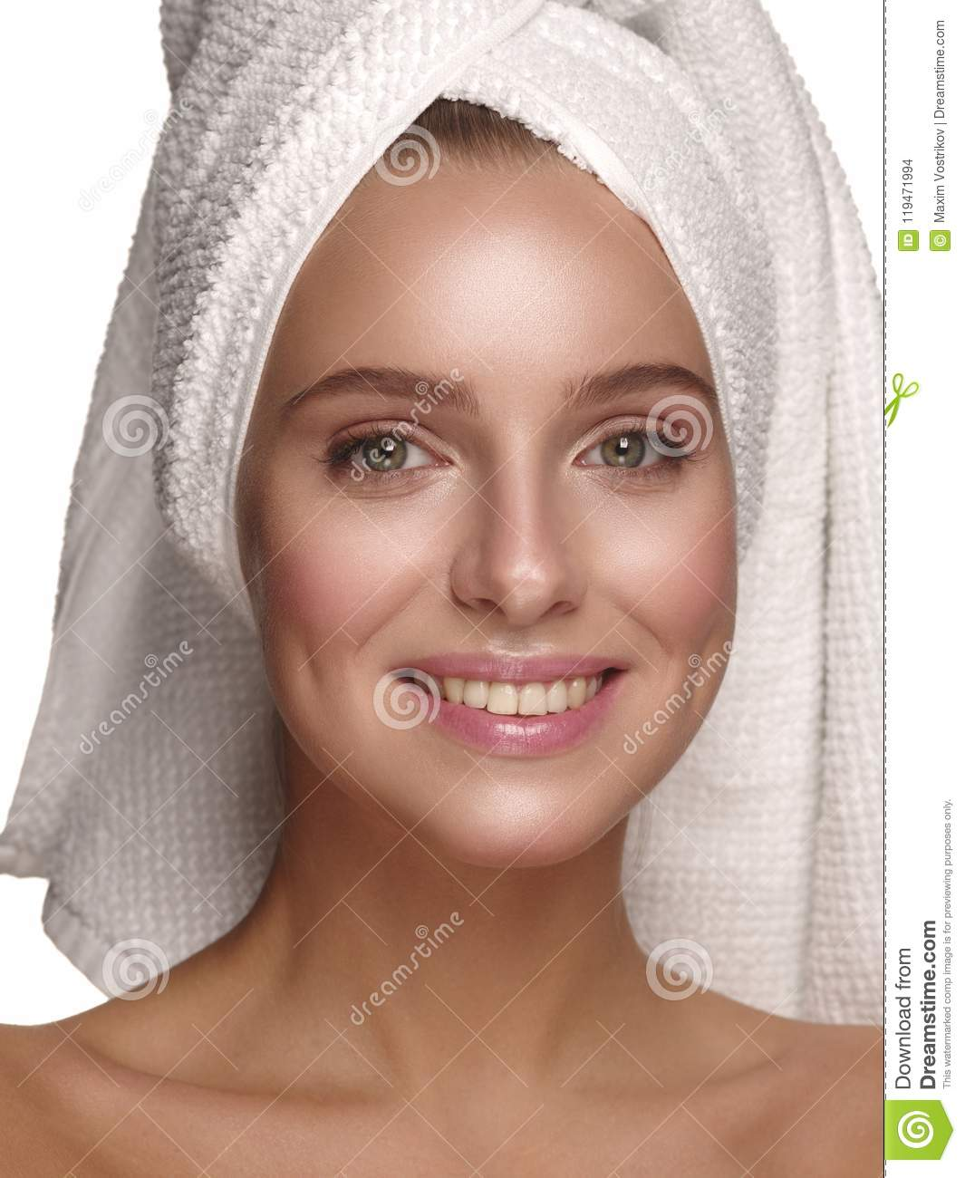 Portrait of a young girl with pure, healthy, smooth and natural glowing skin without any makeup, who is doing daily skincare
