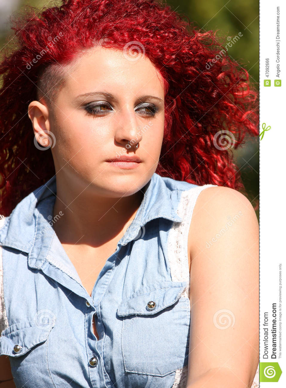 young girl with red hair stock photo image of forest portrait of a young girl with red curly hair and piercing