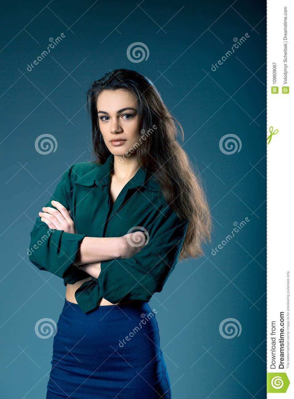 Portrait of young sexy dark-haired model wearing skinny