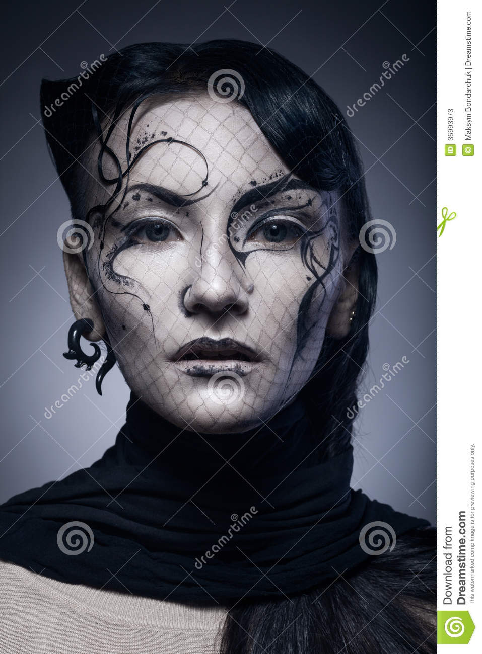 Portrait of young gothic woman isolated on dark