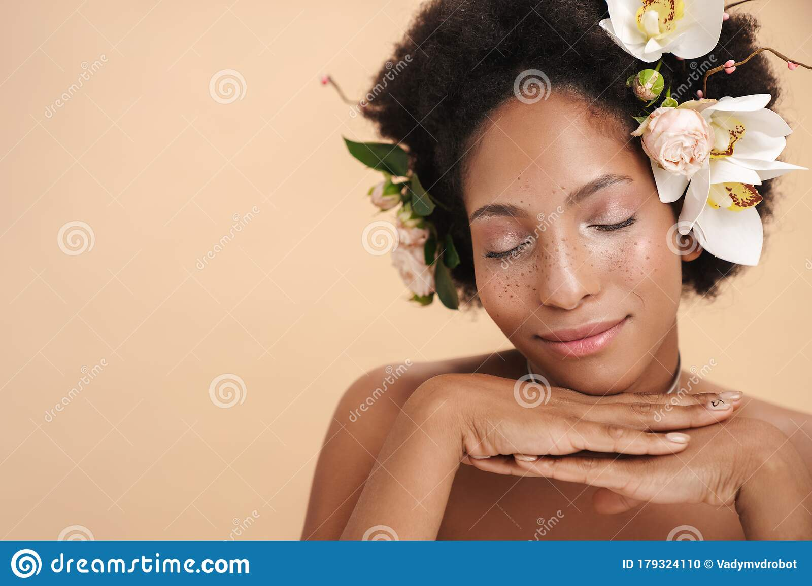 Portrait Of Half-naked African American Woman With Flowers