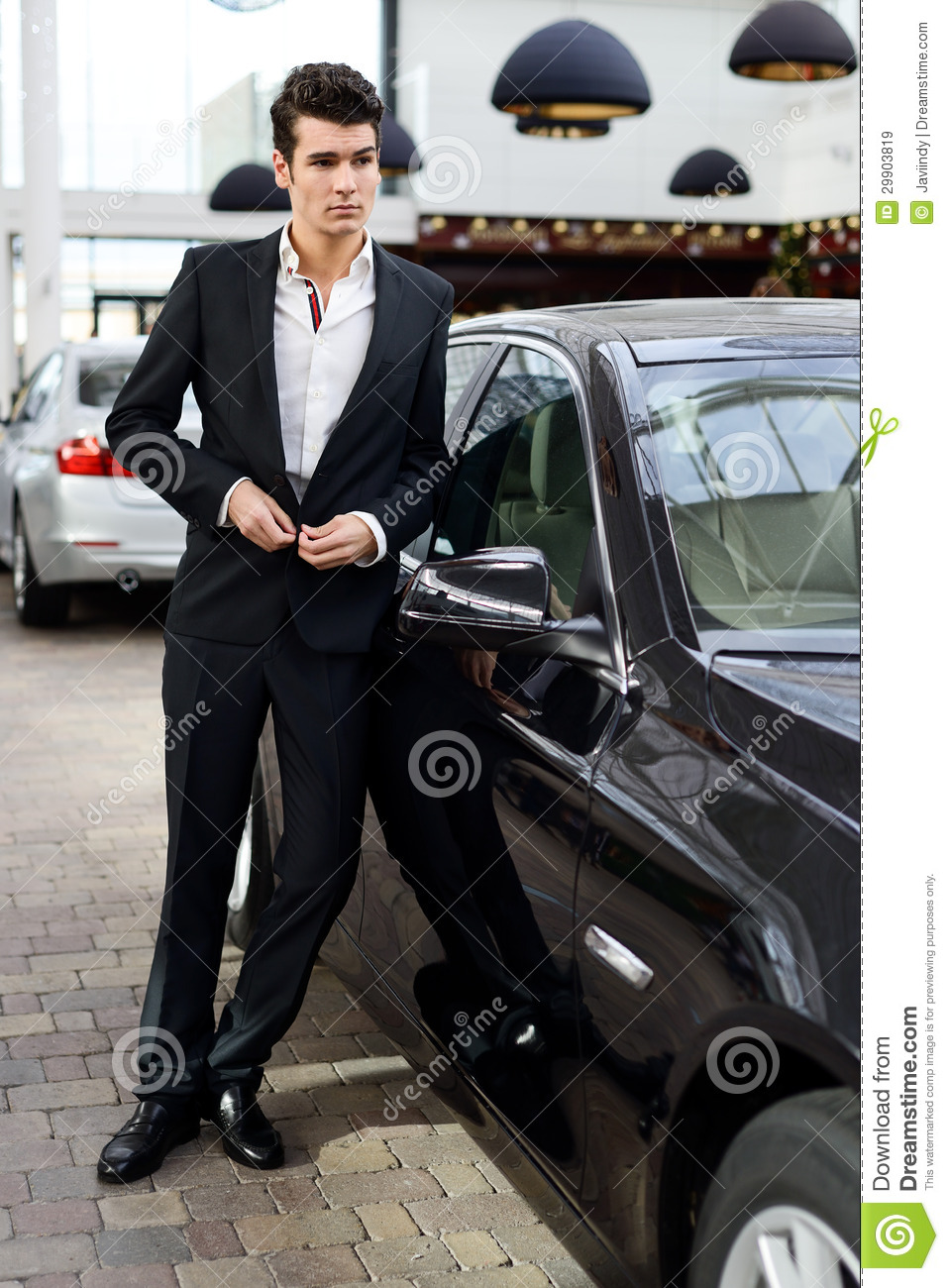 Young Handsome Man Model Of Fashion With Luxury Cars