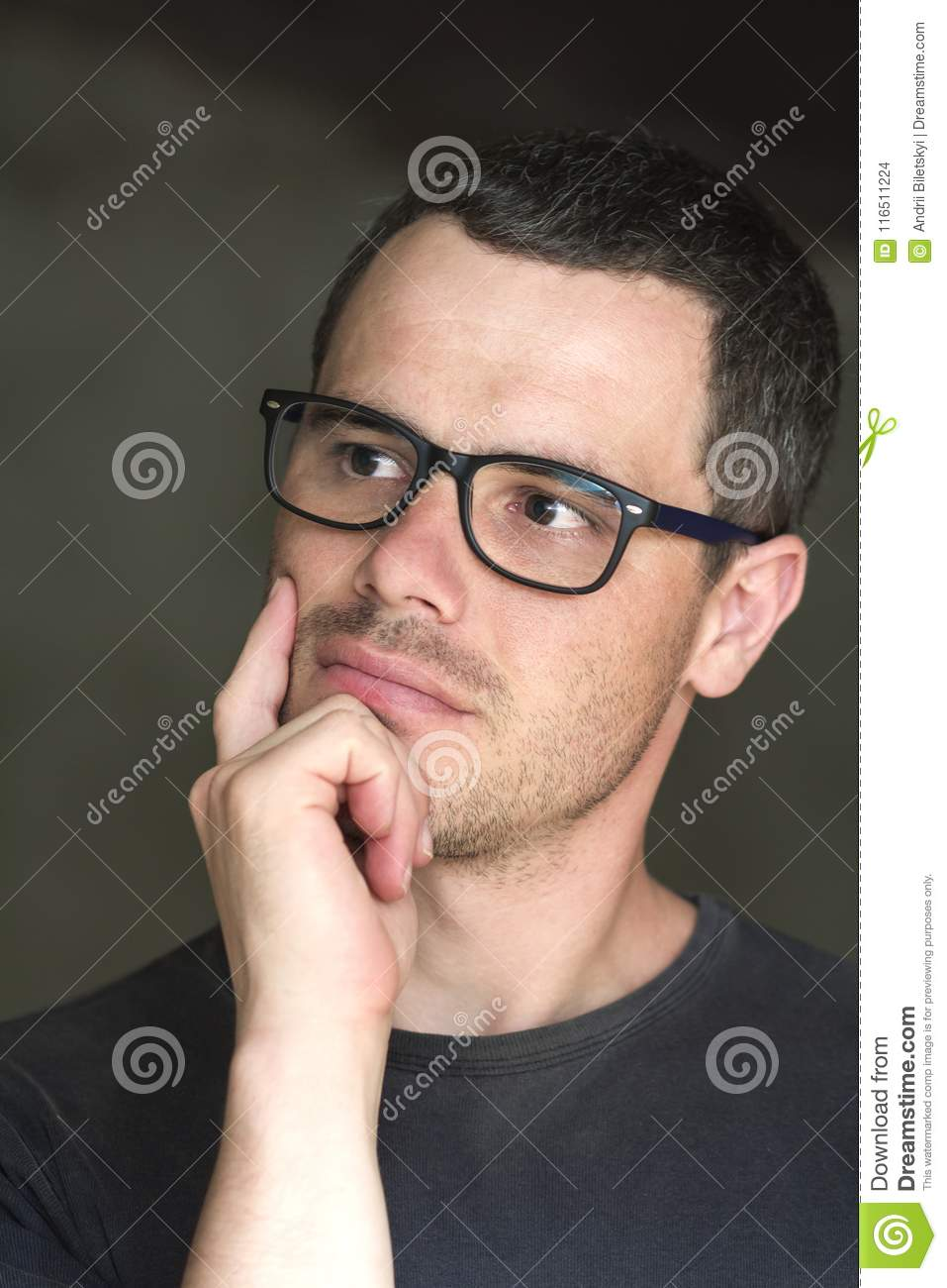 136e0ed3c195 Portrait of young handsome serious black-haired unshaven confident  successful intellectual man in glasses with shiny black eyes looking  thoughtfully into ...