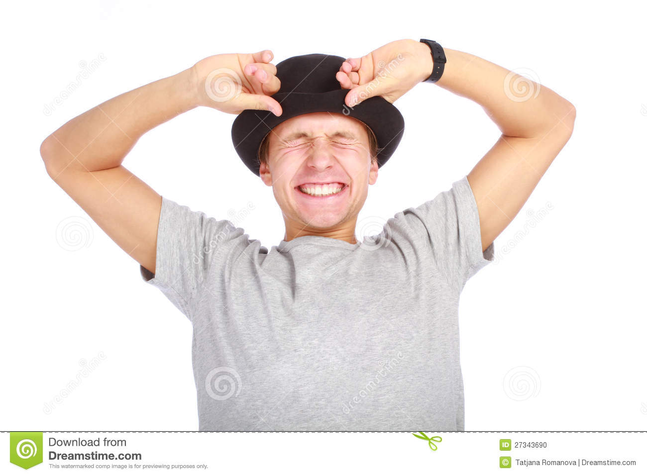 Portrait of young happy man in hat