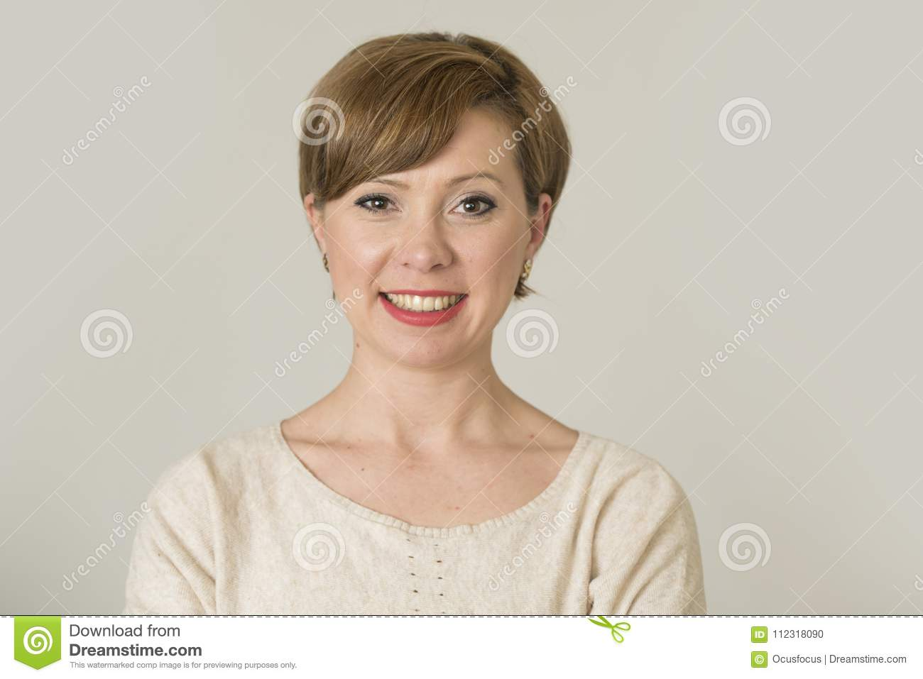 Portrait of young happy and pretty red hair woman on her 30s in