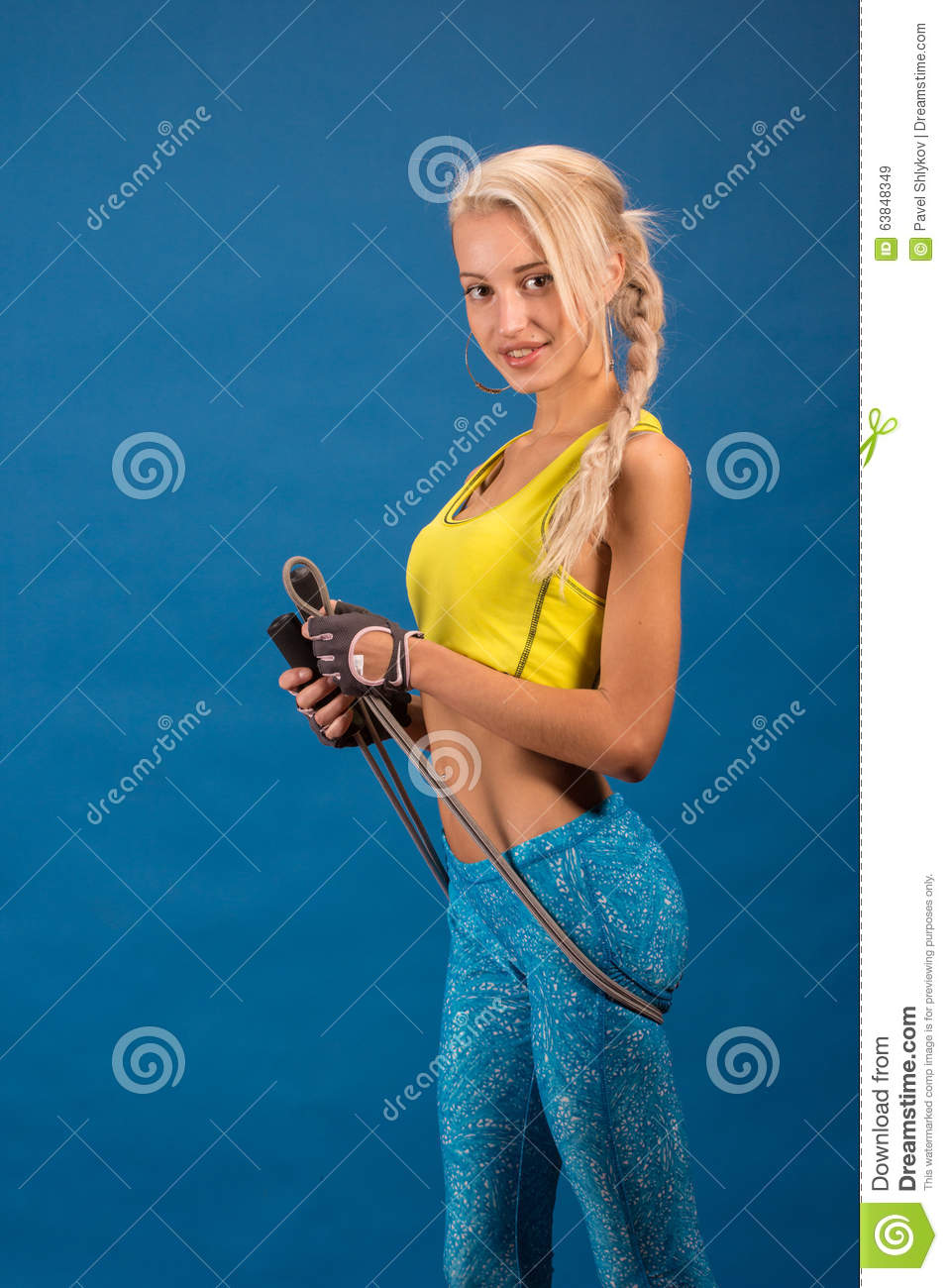 Portrait of young and healthy blonde with skipping rope