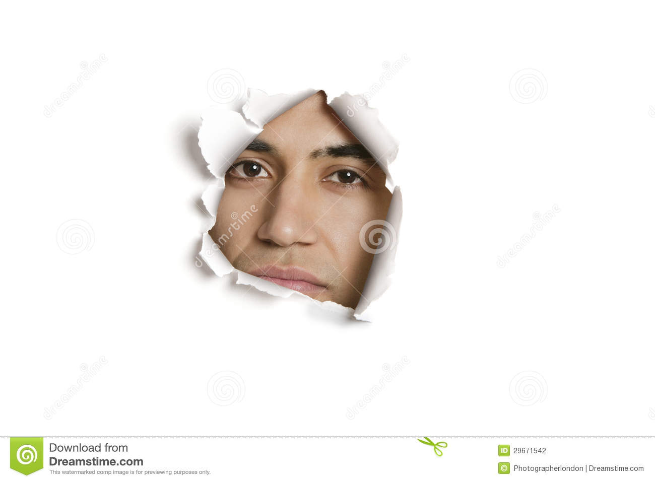 Stock Photography: Portrait of a young Indian man peeking from ripped ...