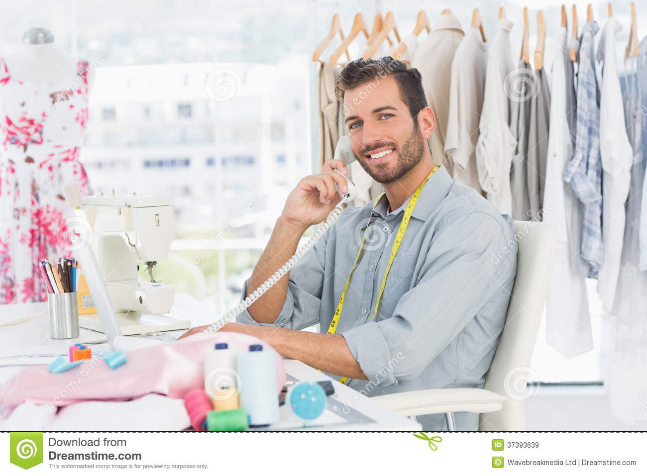 Portrait Of A Young Male Fashion Designer Using Phone Royalty Free ...