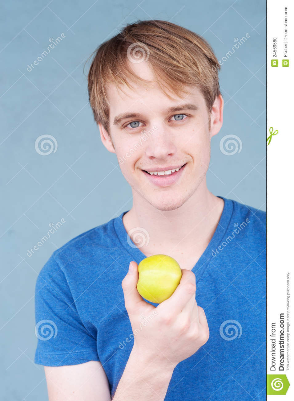 Portrait of a young man with an apple