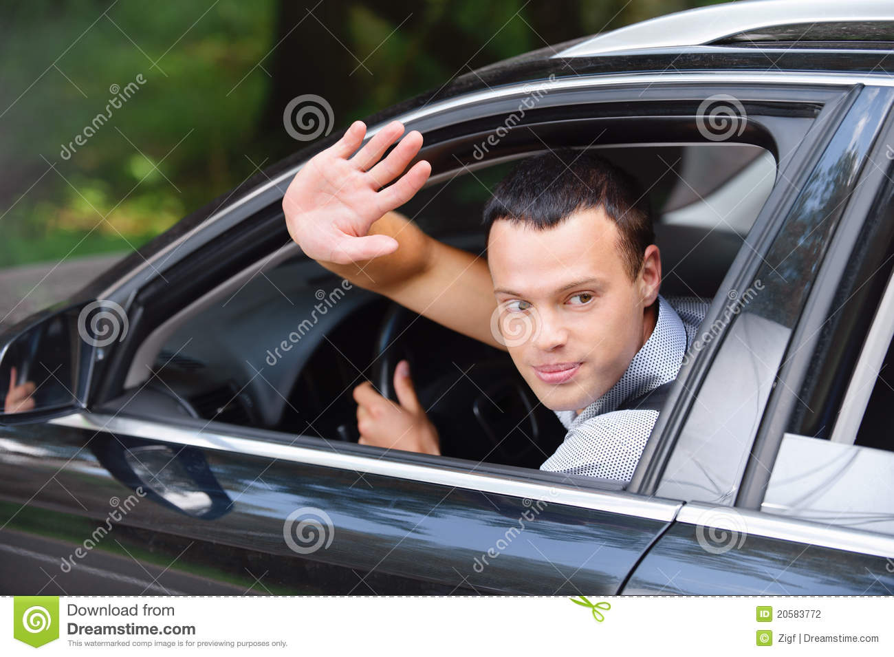 Portrait of young man driving car