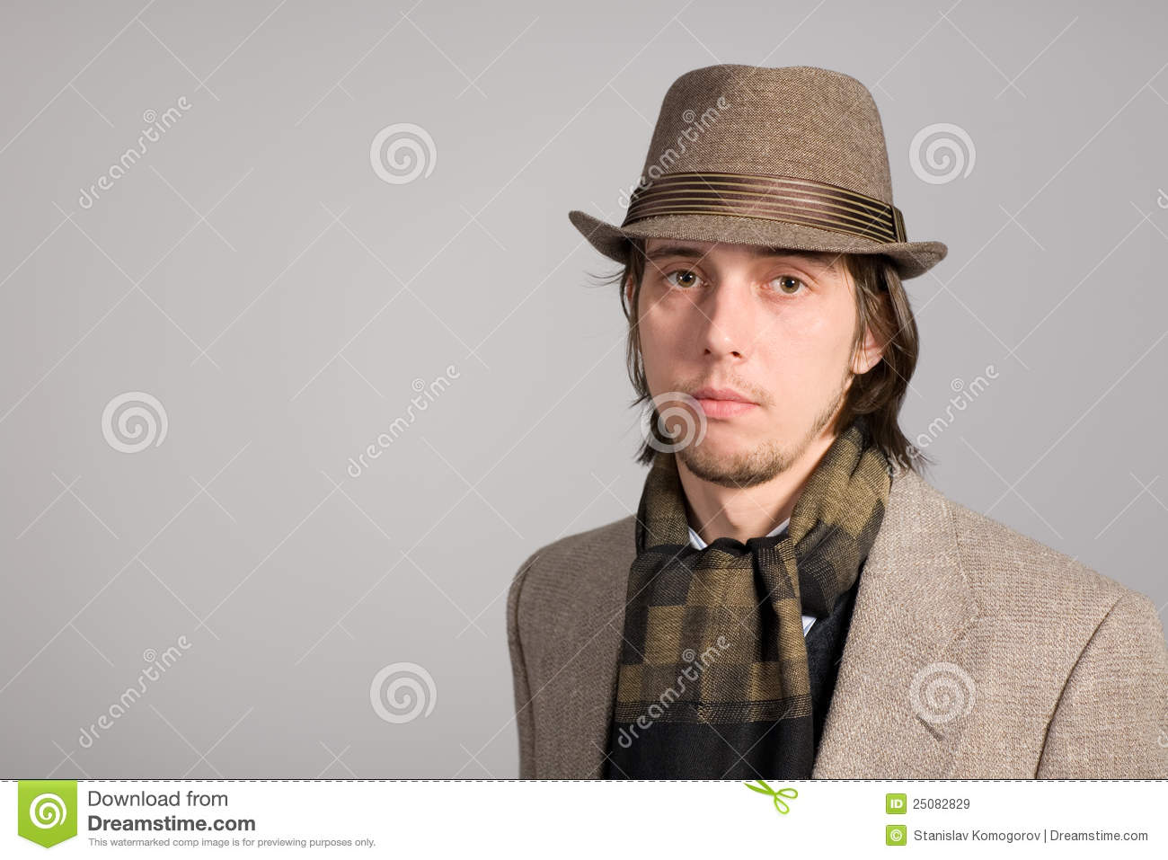 Portrait of a young man in hat