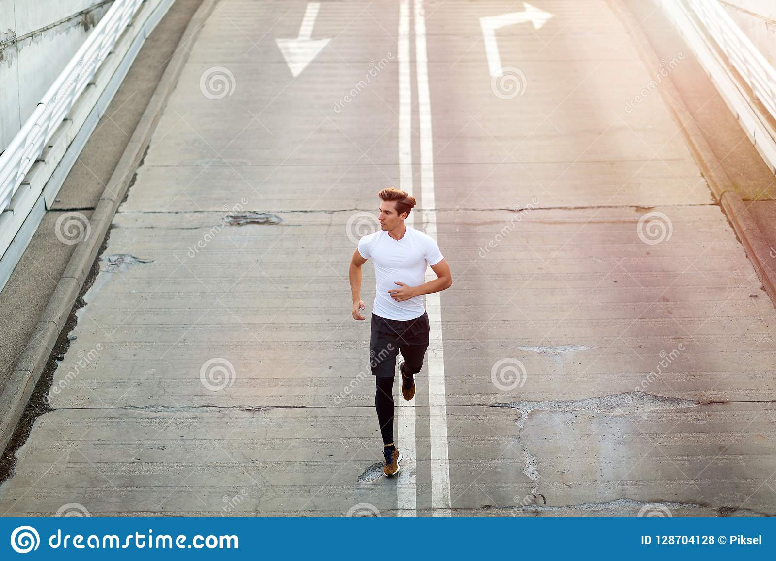 Young Man Running In Urban Area Stock Photo - Image of ...