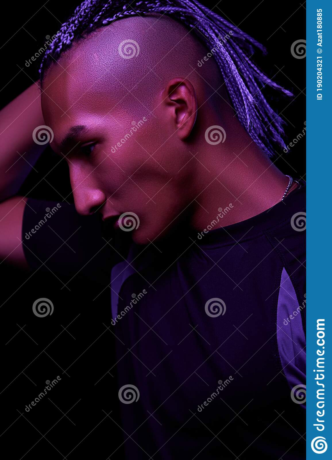 Portrait Of A Young Naked African Man At Studio High Fashion Male Model In Colorful Neon Bright