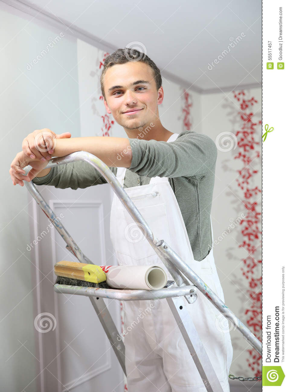 Portrait Of Young Painter Apprentice Putting Wallpaper