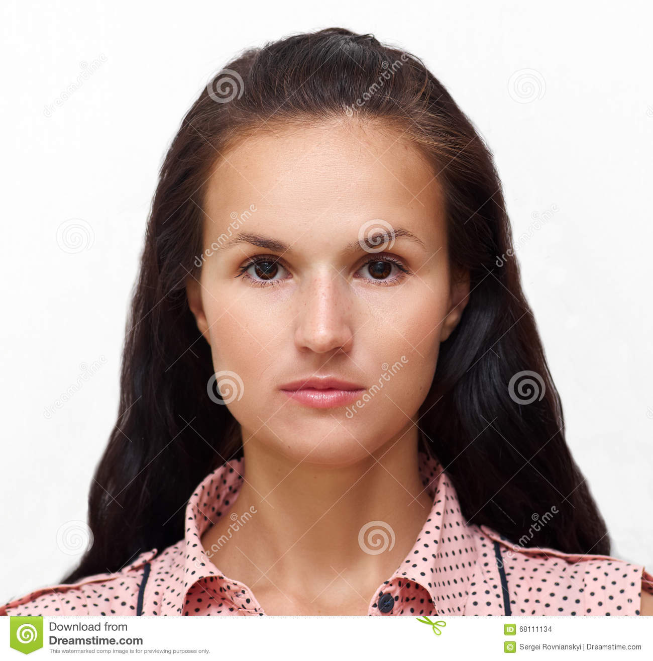 Portrait of a young pretty woman with charming gentle look