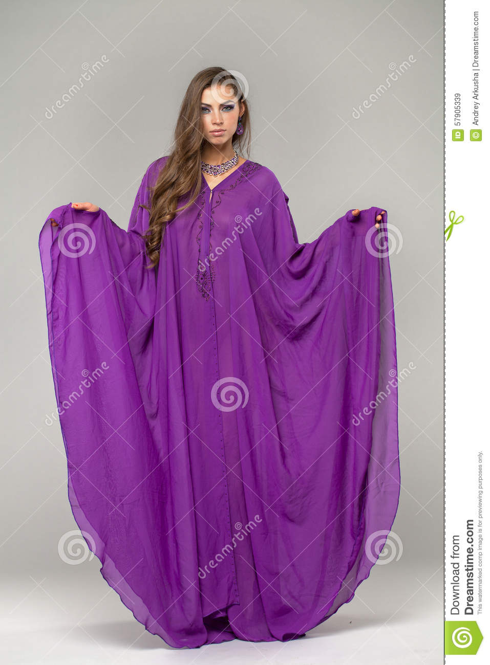 Portrait of the young woman in purple tunic Arabic