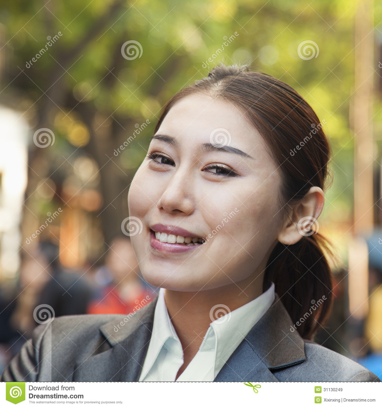 Portrait of young smiling businesswoman in Houhai, Beijing, China