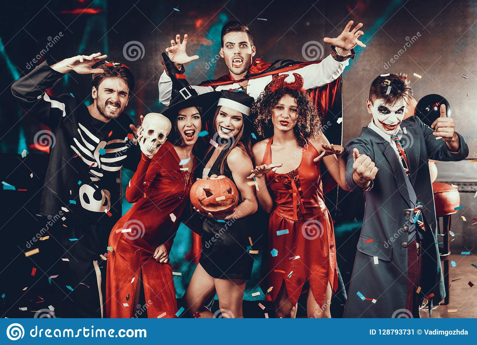 Halloween Group Costumes Scary.Portrait Of Young Smiling People In Scary Costumes Stock