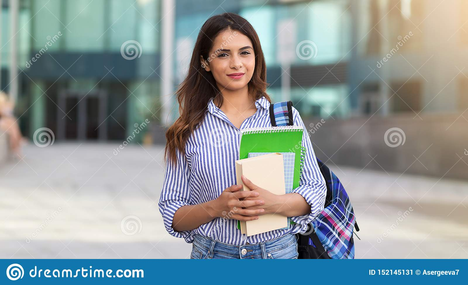 Portrait of young smiling woman holding books, study, education, knowledge, goal concept