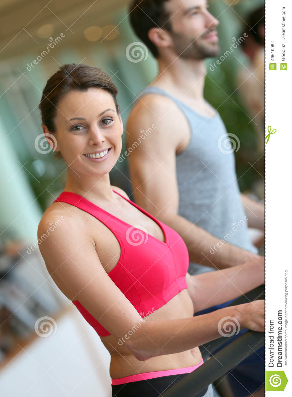 Young Adults Working Out In Fitness Club Stock Photo ...