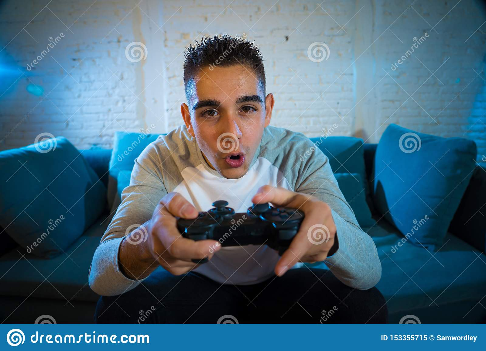 Close Up Portrait Of Young Addicted Man Playing Video Game At Night In Gaming And Addiction Concept Stock Image Image Of Couch Online 153355715