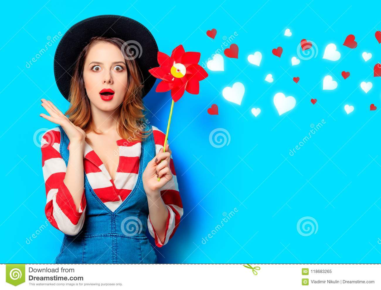 Woman with red pinwheel with hearts