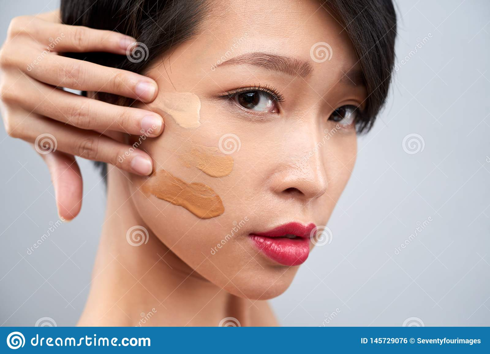Woman Applying Foundation Swatches On Cheek Stock Photo Image Of Complexion Hand 145729076