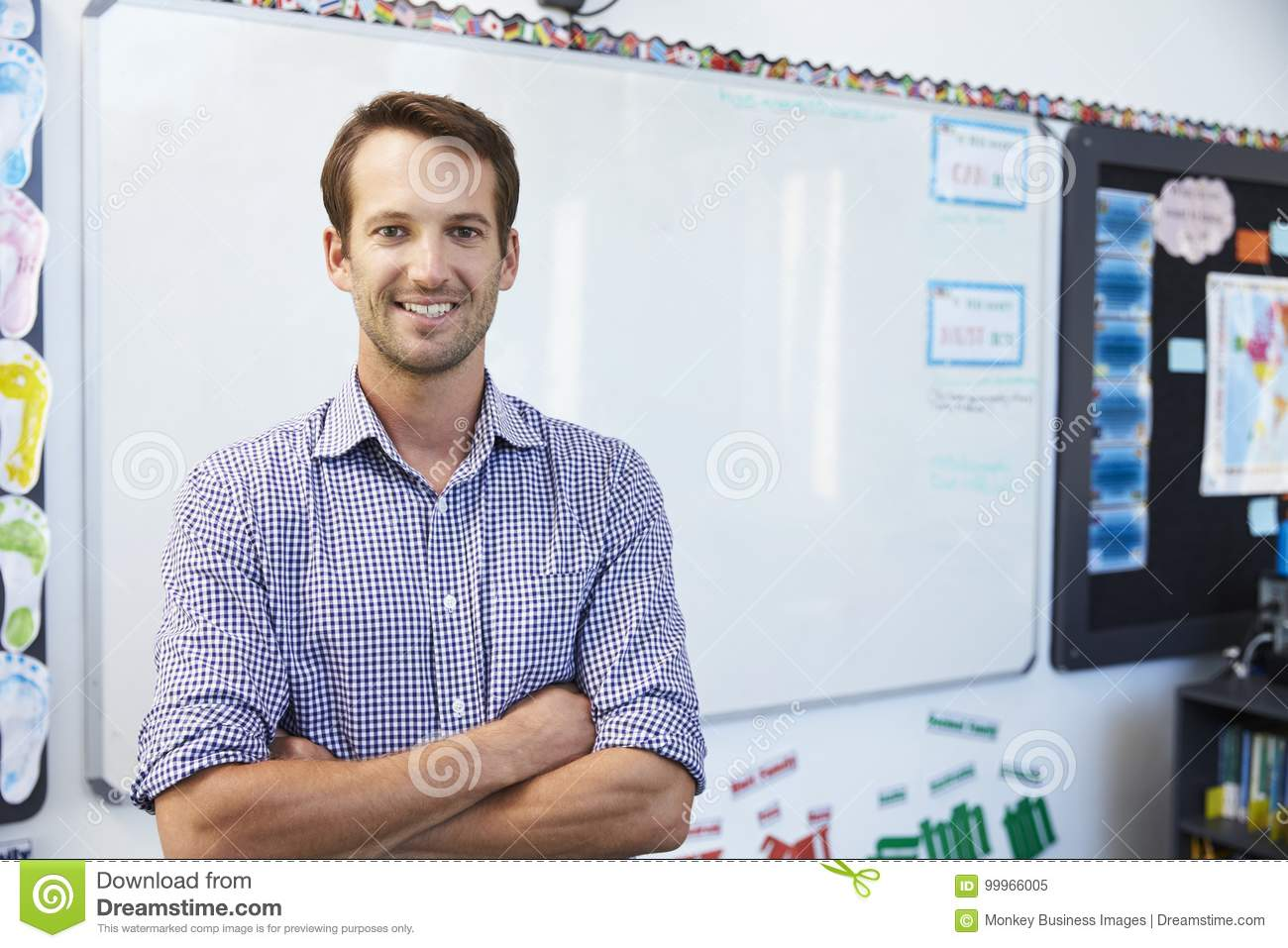 Portrait of young white male teacher in school classroom