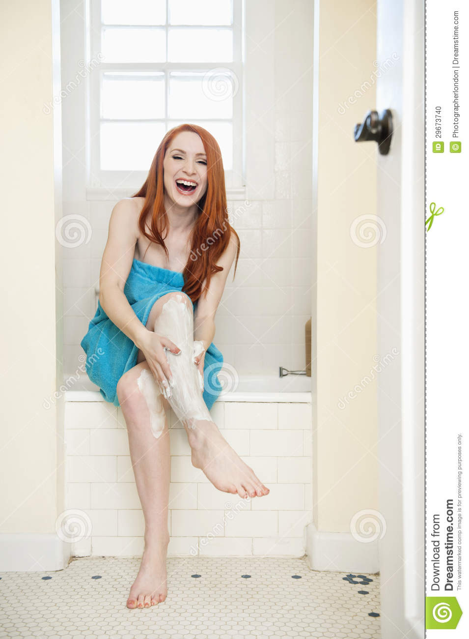 portrait of a young woman in bathroom applying cream on ForBathroom Photos Of Ladies