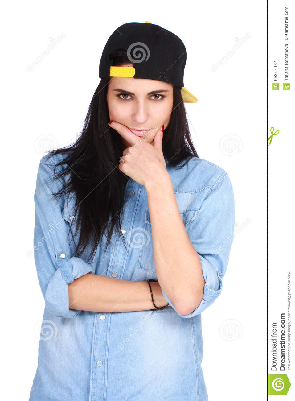 Portrait of young woman in cap posing on white