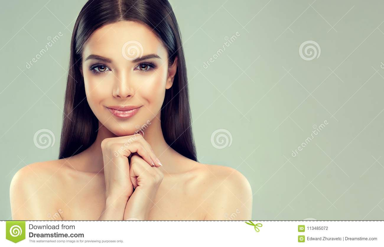 Portrait of young woman with clean fresh skin, soft, delicate make up and untied straight hairstyle.