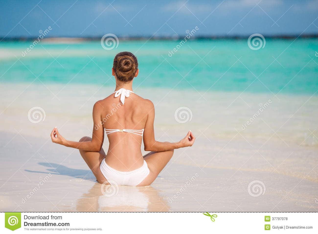 Portrait Of Young Woman Doing Yoga Exercises On Tropical ...
