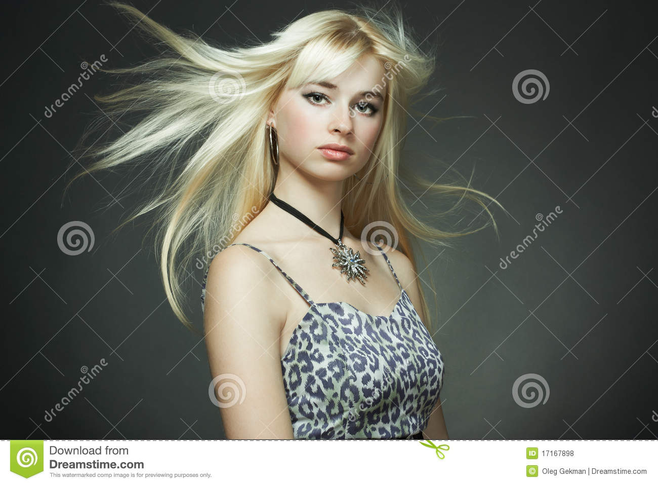 Portrait of the young woman with flying hair