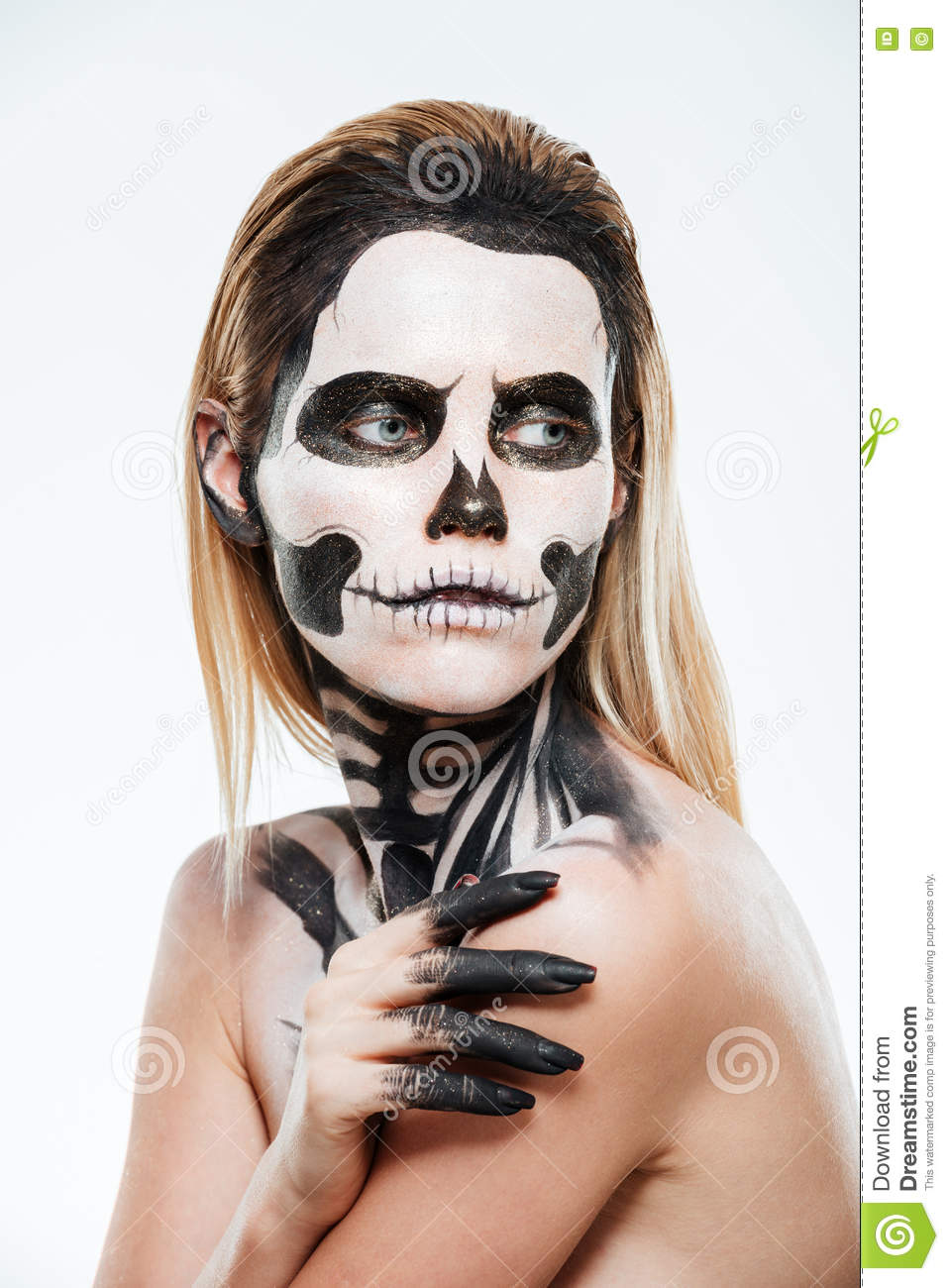 portrait of young woman with gothic halloween makeup stock photo