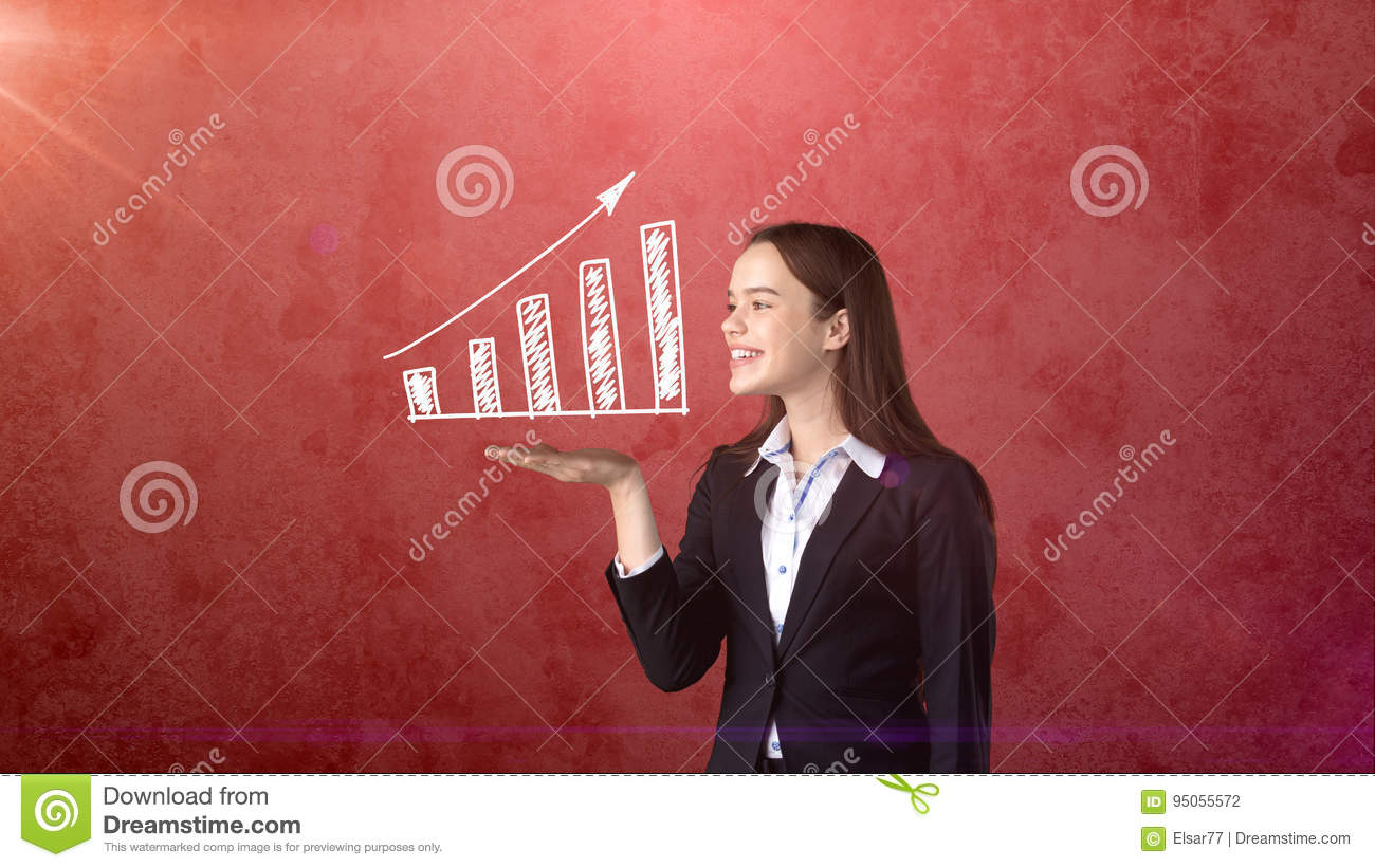 Portrait of young woman holding white painted growing chart on the open hand palm, isolated background. Business concept