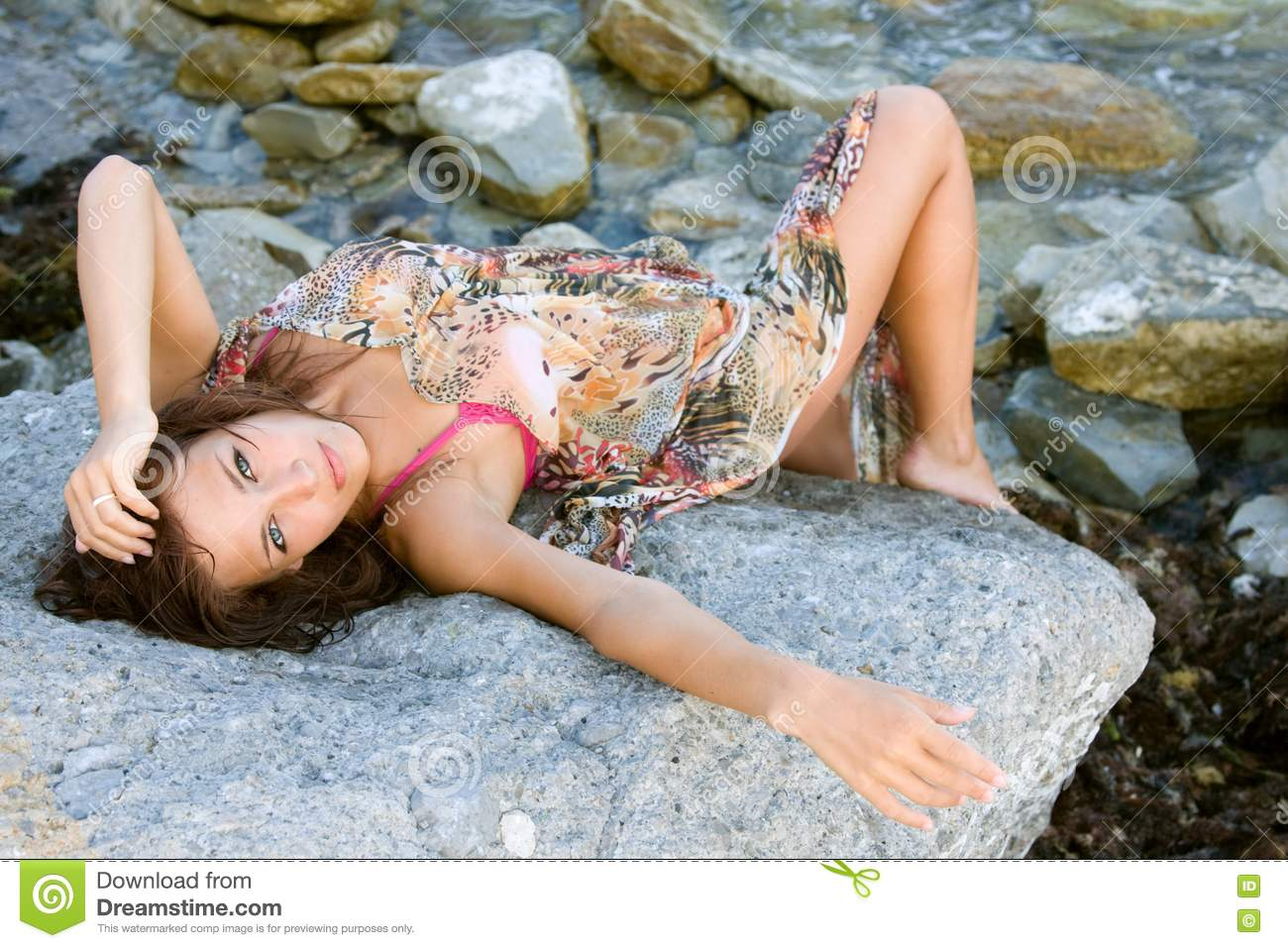 Royalty Free Stock S Portrait Of A Young Woman Lying On Rock