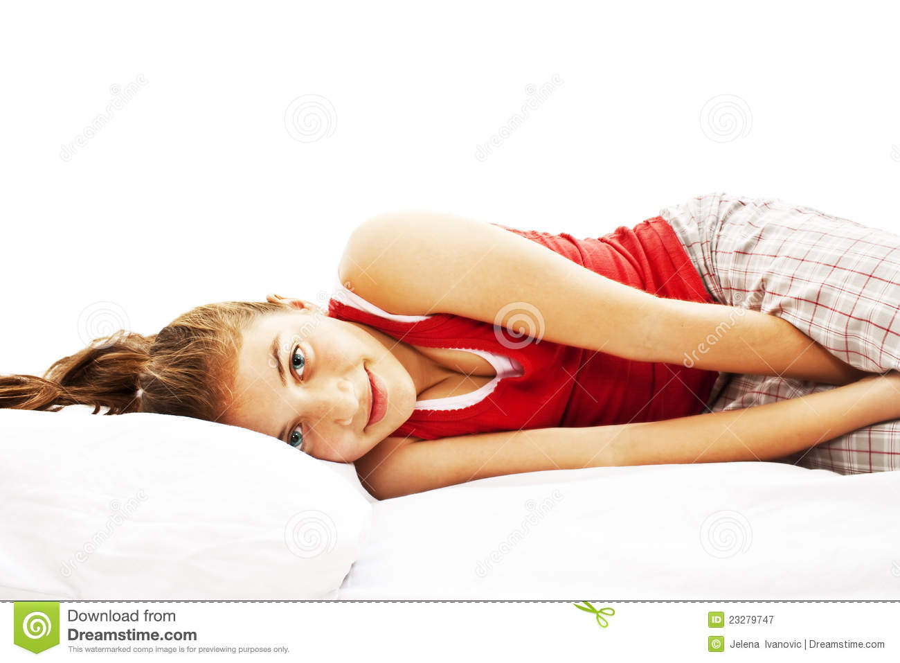 Portrait Of Young Woman In Pajamas Laying In Bed Royalty