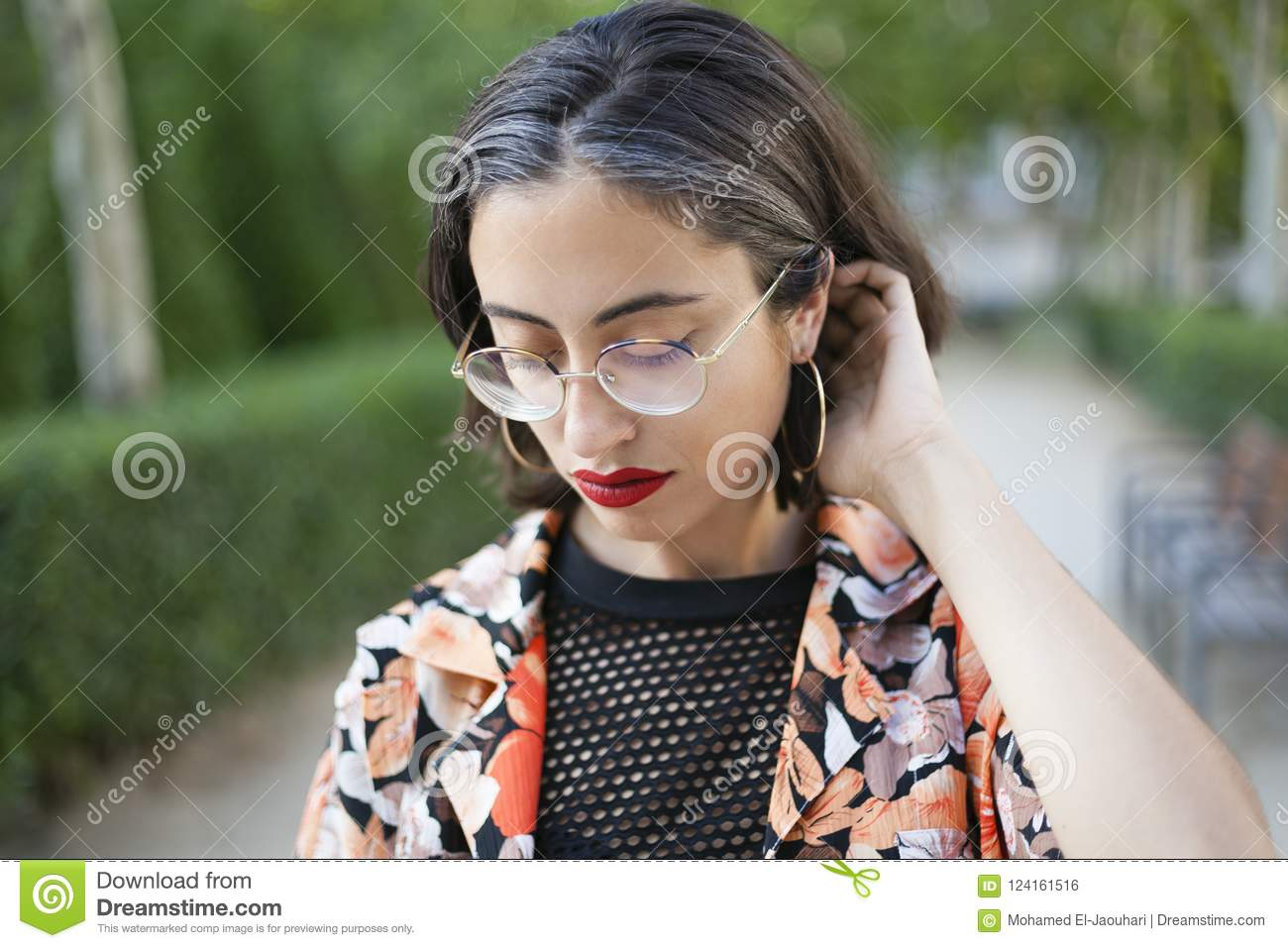 Trendy girl with glasses portrait.