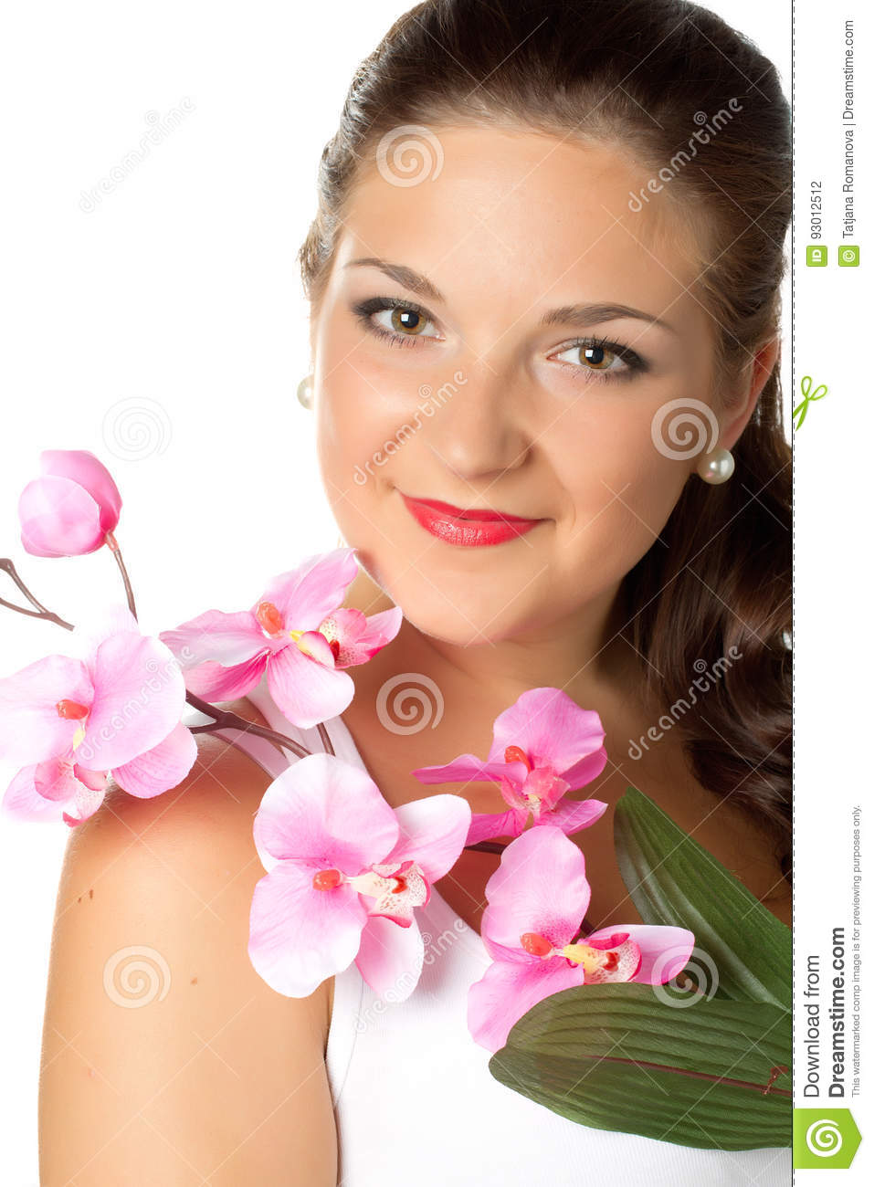 Portrait of young woman and pink orhid on white