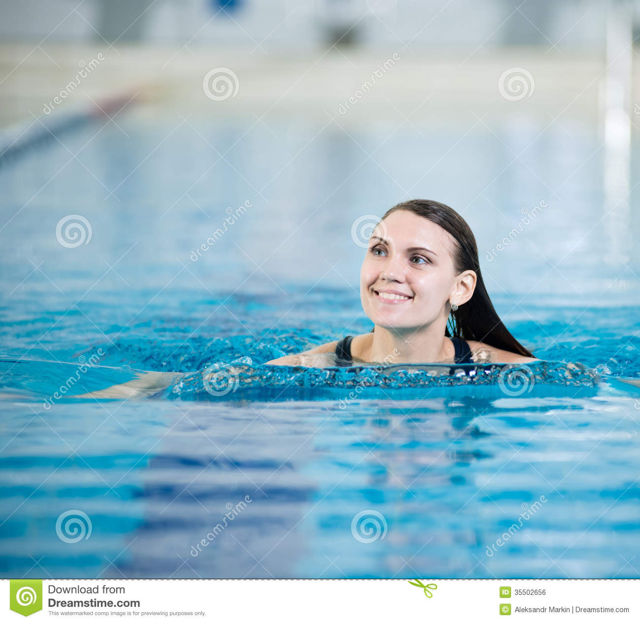 Portrait of a young woman in sport swimming pool stock - How long after pool shock before swim ...