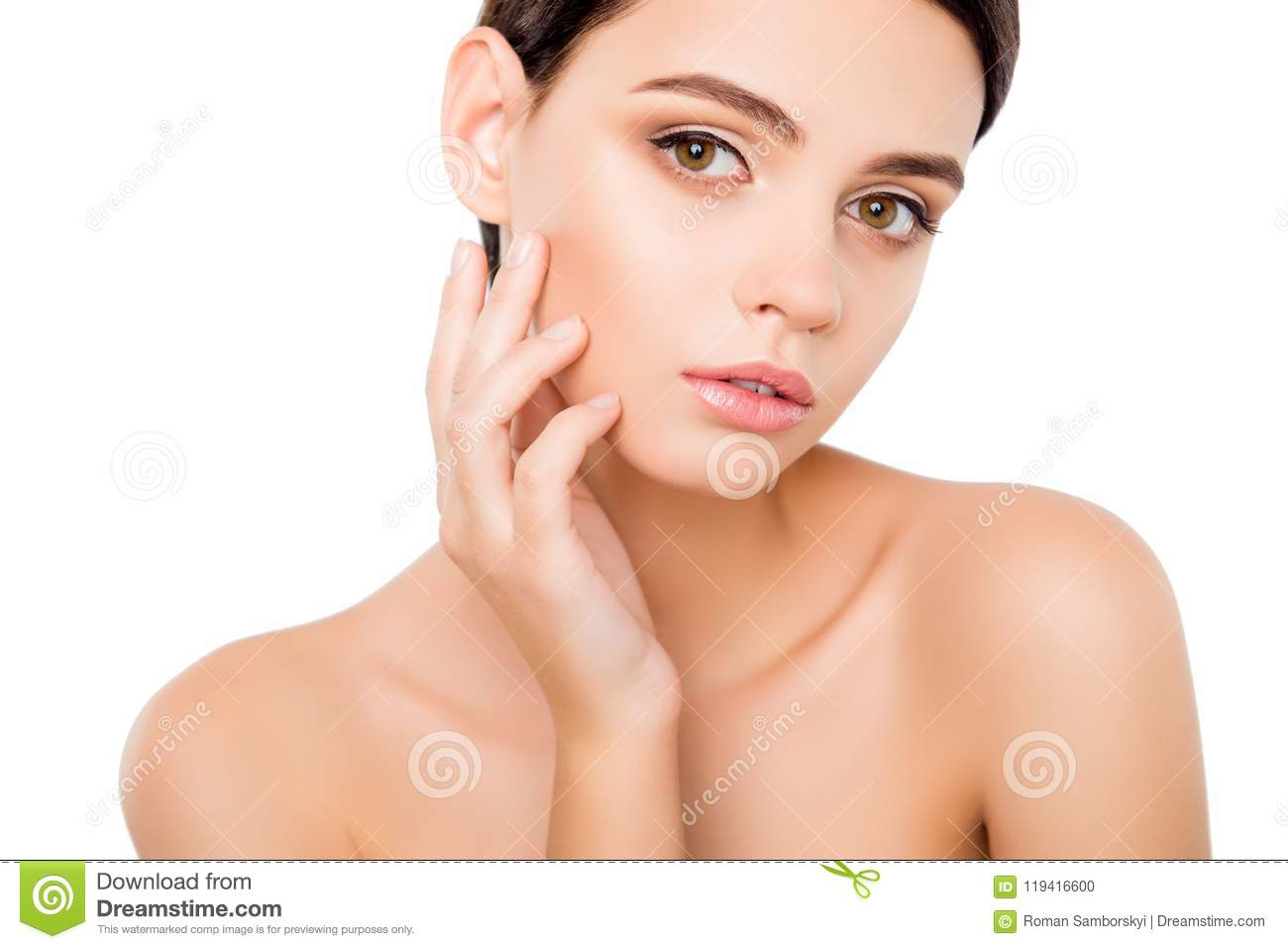 Portrait of young woman touching skin on her cheek. Close up portrait of charming lovely pretty beautiful attractive lady isolated