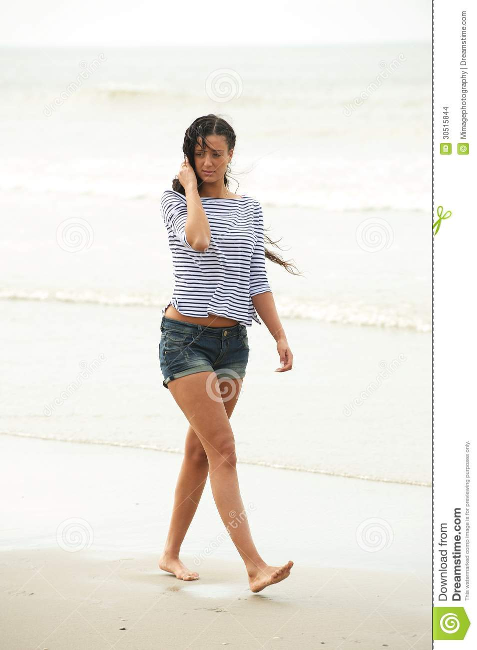 Portrait Of A Young Woman Walking On The Beach Alone Stock ...