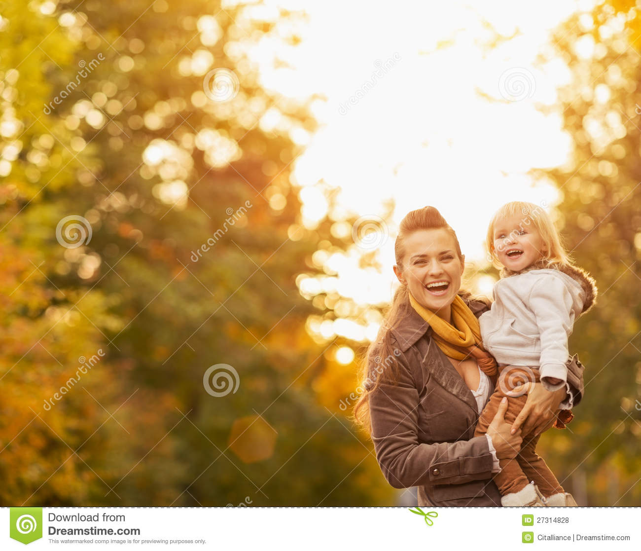 Portraits of happy young mother and baby outdoors