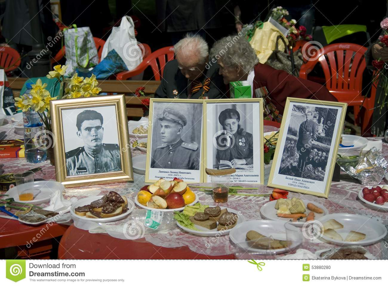 Portraits of veterans in frames put on a table editorial for Table moscow