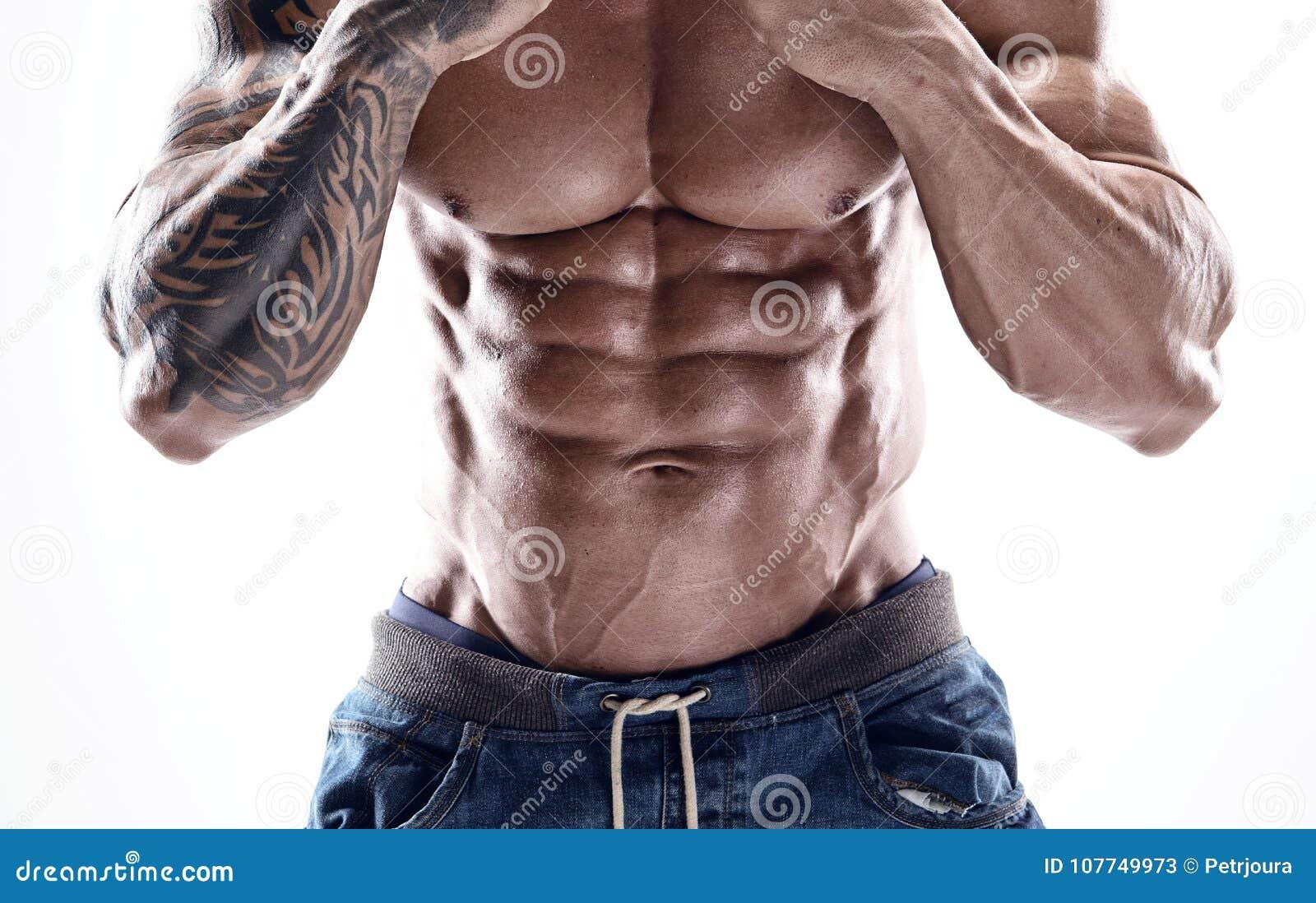 Portret silny Sportowy sprawność fizyczna mężczyzna pokazuje dużych mięśnie